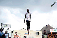 SOWETO,SOUTH AFRICA: Girls play on a trampolineon a street cornerin Soweto, South Africa.Soweto is the largest township in South Africa, located about 10 kilometers southwest of downtown Johannesburg. The population is estimated to be around 2-3 million.(Photo by Per-Anders Pettersson)
