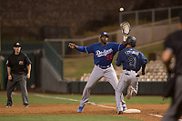 Los Angeles Dodgers first baseman Ibandel Isabel (90) prepares to catch a ball over the head of Cesar Izturis Jr. (21) during a Minor League Spring Training game against the Seattle Mariners at Camelback Ranch on March 28, 2018 in Glendale, Arizona. (Zachary Lucy/Four Seam Images)