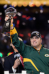 Green Bay Packers head coach Mike McCarthy holds up the Lombadi Trophy after winning Super Bowl XLV against the Pittsburgh Steelers on Sunday, February 6, 2011, in Arlingto, Texaas. The Packers won 31-25. (AP Photo/David Stluka)