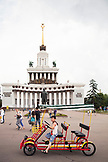 RUSSIA, Moscow. Tourists and local visitors in front of the Valdimir Lenin Monument at the All-Russia Exhibition Center.