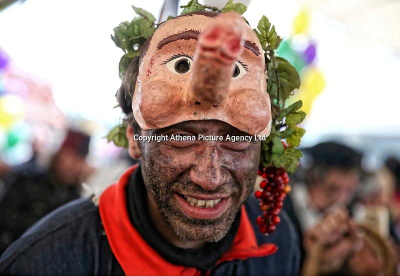 Pictured: A man with a penis-shaped mask in Tirnavos, central Greece. 19 February 2018<br /> Re: Bourani (or Burani) the infamous annual carnival which dates to 1898 which takes place on the day of (Clean Monday), the first days of Lent in Tirnavos, central Greece, in which men hold phallus shaped objects as scepters in their hands.