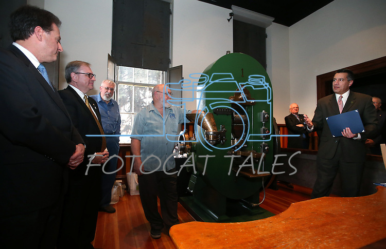 Nevada Gov. Brian Sandoval, right, speaks during a ceremony marking the beginning of production of the second design in a four-part series of Sesquicentennial medallions at the Nevada State Museum, in Carson City, Nev., on Wednesday, Feb. 26, 2014. From left, Lt. Gov. Brian Krolicki, Kirk V. Clausen with Wells Fargo, Nevada State Museum Curator Bob Nylen and coiner Ken Hopple were among the dignitaries on hand for the event.<br /> Photo by Cathleen Allison/Nevada Photo Source