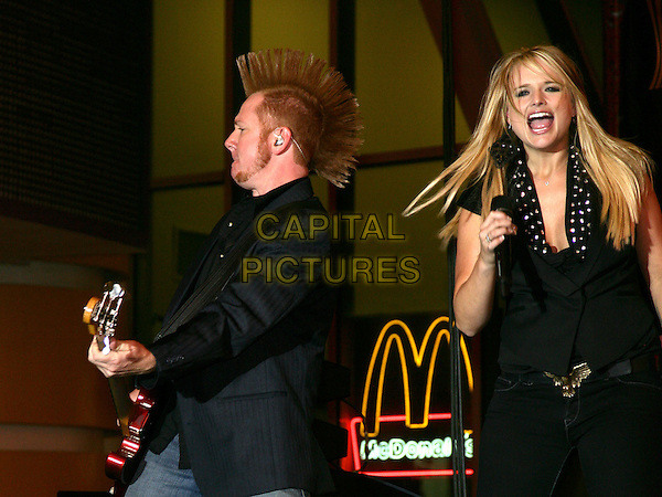 MIRANDA LAMBERT.Miranda Lambert Performs at the ACM Weekend at the Freemont Street Experience, Las Vegas, Nevada, USA..April 17th, 2010.stage concert live gig performance music half length black top singing mohawk guitar .CAP/ADM/MJT.© MJT/AdMedia/Capital Pictures.