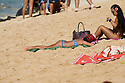 Girl sunbathing at Off the Wall  on the Northshore of Oahu in Hawaii.