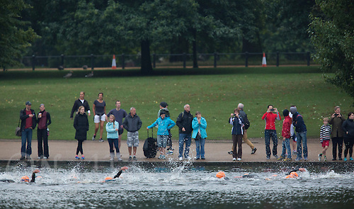 14 SEP 2013 - LONDON, GBR - Spectators watch competitors during the swim at the elite women's ITU 2013 World Triathlon Series Grand Final in Hyde Park, London, Great Britain (PHOTO COPYRIGHT © 2013 NIGEL FARROW, ALL RIGHTS RESERVED)