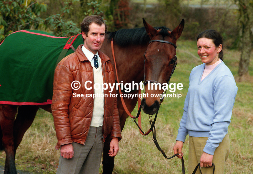 George & Rosemary Stewart, Danescroft, Waterloo Road, Lisburn, N Ireland, BT27 5NJ, with Excursion who is a runner in the 1985 Cheltenham Gold Cup. George is the trainer and Rosemary is the jockey. The horse was withdrawn because of the unsuitable firm going. 19850013GS+RS1..Copyright Image from Victor Patterson, 54 Dorchester Park, Belfast, UK, BT9 6RJ..Tel: +44 28 9066 1296.Mob: +44 7802 353836.Voicemail +44 20 8816 7153.Skype: victorpattersonbelfast.Email: victorpatterson@mac.com.Email: victorpatterson@ireland.com (back-up)..IMPORTANT: If you wish to use this image or any other of my images please go to www.victorpatterson.com and click on the Terms & Conditions. Then contact me by email or phone with the reference number(s) of the image(s) concerned.