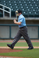 Home plate umpire Austin Jones rubs up a baseball during the Southern League game between the Pensacola Blue Wahoos and the Birmingham Barons at Regions Field on July 7, 2019 in Birmingham, Alabama. The Barons defeated the Blue Wahoos 6-5 in 10 innings. (Brian Westerholt/Four Seam Images)