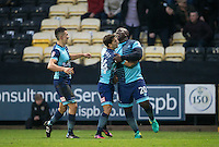 Adebayo Akinfenwa of Wycombe Wanderers celebrates his goal with Scott Kashket of Wycombe Wanderers & Luke O'Nien (left) of Wycombe Wanderers during the Sky Bet League 2 match between Notts County and Wycombe Wanderers at Meadow Lane, Nottingham, England on 10 December 2016. Photo by Andy Rowland.