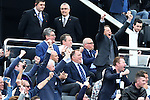 Newcastle owner Mike Ashley remains seated whilst fans around him celebrate his sides opening goal during the Barclays Premier League match at St James' Park. Photo credit should read: Philip Oldham/Sportimage