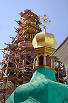 Travel stock photo of a Church dome with a cross and a Bell tower in scaffolding being restored and renovated Kiev pechersk lavra Cave monastery in Kiev Ukraine Eastern Europe Architecture in Ukrainian baroque architectural style Vertical May 2007