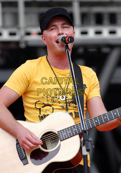 ROBERT POST.Performs at the 43rd FestivalBar, Rome, Itlay,.7th July 2006..half length music festival bar concert on stage gig live  guitar yellow t-shirt cap hat.Ref: CAV.www.capitalpictures.com.sales@capitalpictures.com.©Luca Cavallari/Capital Pictures.