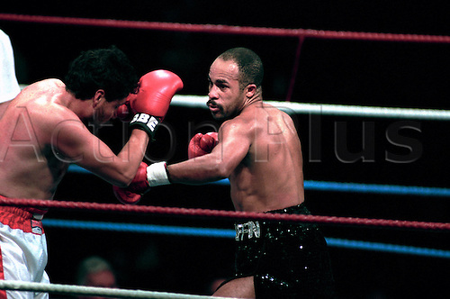 April 22, 1992: Boxer LLOYD HONEYGHAN (GBR)(black shorts) during a Light Middleweight bout against Alfredo Ramirez, Wembley, England. Photo: Peter Tarry/Action Plus...920422 boxing boxers combat fighter fighters
