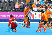 Argentina goalkeeper Juan Vivaldi clears a shot from Malaysia's Haziq Samsul during the Hockey World League Semi-Final match between Argentina and Malaysia at the Olympic Park, London, England on 24 June 2017. Photo by Steve McCarthy.