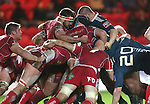 The front rows clash with Scarlets hooker Emyr Phillips in the middle of the scrum.<br /> Celtic League<br /> Scarlets v Munster<br /> <br /> 01.03.14<br /> <br /> ©Steve Pope-SPORTINGWALES