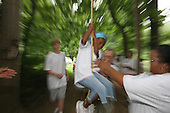 Danielle Chollette 6 of Alexandria, Va., gets a helping hand on a rope swing exercise on Saturday July 30, 2005. Danielle attended The Point of Hope's three day camp in Darlington, Md, due to a recent loss of her father. Not only she is in the camp but so is her brother and mother. The camp is geared towards men, women and children who have recently suffered the loss of a loved one. Jane Therese for The Newhouse News Service.