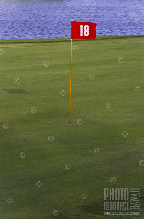 The red flag of the 18th hole on a Big Island golf course.