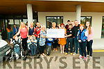 Cheque presentation : Members of the north Kerry cycling club who presented a cheque for €7578.00, the proceeds of a poker run held earlier this year to Gabrielle Browne, principal Nano Nagle  School, Listowel on Friday last.