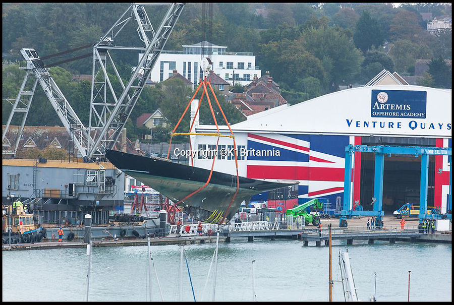 BNPS.co.uk (01202 558833)<br /> Pic: K1Britannia/BNPS<br /> <br /> ***Please Use Full Byline***<br /> <br /> The Britannia being lowered into the water to be taken to Hythe.<br /> <br /> An 8 million pounds appeal has been launched to resurrect one of the most famous and best loved racing yachts of all time - the 'King's yacht' Britannia.<br /> <br /> The historic 177ft yacht was built for playboy prince Albert in 1893 and became an instant star of the sailing scene, winning 33 of 43 prestigious races  in her first year alone.<br /> <br /> The stunning Royal yacht became known the world over and enjoyed an illustrious racing career at the hands of Albert, who went on to become King Edward VII.<br /> <br /> Edward's son George V continued the love affair with Britannia, dubbed 'the King's yacht', so much so that on his death in 1936 she was deliberately sunk off the Isle of Wight.<br /> <br /> Now, 78 years on, campaigners are nearing the final stages of a project to complete an an inch-perfect replica of Britannia which has been 20 years in the making.<br /> <br /> The instantly recognisable hull is finished but around six million pounds is needed to transform it into a yacht worthy of Royalty. <br /> <br /> The yacht, which will cost an extra one million pounds a year to run, will then be taken all round the world so it can be enjoyed by charities and future generations.