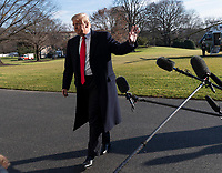 United States President Donald J. Trump waves to the media as he returns to the White House in Washington, DC after a day trip to Camp David on Sunday, January 6, 2019. Photo Credit: Chris Kleponis/CNP/AdMedia