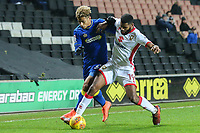 Ethan Ebanks-Landell of MK Dons (right) holds off Lyle Taylor of AFC Wimbledon (left) during the Sky Bet League 1 match between MK Dons and AFC Wimbledon at stadium:mk, Milton Keynes, England on 13 January 2018. Photo by David Horn.
