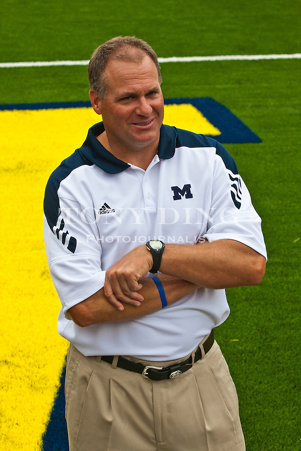 Michigan head coach Rich Rodriguez on the Michigan Stadium turf, at the annual NCAA college football media day, Sunday, Aug. 22, 2010, in Ann Arbor, Mich. (AP Photo/Tony Ding)