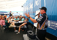 Oct 17, 2015; Ennis, TX, USA; Bob Wilber a crew member for NHRA funny car driver Tim Wilkerson speaks to visitors in the teams hospitality tent in the pits during qualifying for the Fall Nationals at the Texas Motorplex. Mandatory Credit: Mark J. Rebilas-USA TODAY Sports