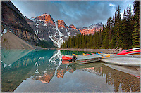 Early morning at Moraine Lake in Banff National Park, and the waters are quiet. The colorful boats are still ashore and everyone except me was still asleep. But I have to say, they missed a beautiful sunrise in the Canadian Rockies.