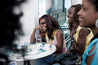 ADDIS ABABA, ETHIOPIA - NOVEMBER 16: Girlfriends have coffee and chat at Kaldis, a popular cafe on November 16, 2010 in the Friendship shopping mall in Addis Ababa, Ethiopia. Some people can afford to buy expensive locally  and imported cloths despite that this one of Africa's poorest countries. (Photo by Per-Anders Pettersson)