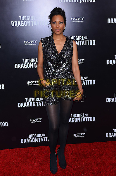 """Aisha Tyler.""""The Girl With The Dragon Tattoo"""" New York Premiere, New York City, NY, USA..December 14th, 2011.half length black  sequins sequined tights playsuit hand in pocket .CAP/ADM/CS.©Christopher Smith/AdMedia/Capital Pictures."""