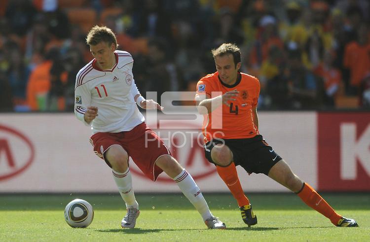 Nicklas Bendtner of Denmark takes on Joris Mathijsen of the Netherlands