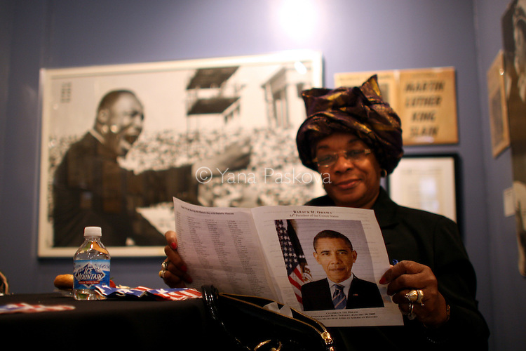 Ovajean Pinckney, 67, retired teacher from Chicago, reads a Barack Obama pamphlet in front of a picture of civil rights leader Martin Luther King Jr. before watching the inauguration of Obama as President of the United States in the theater of the DuSable Museum of African-American History in Chicago, Illinois, on the Presidential Inauguration Day, Tuesday, January 20, 2009.  (Photo by Yana Paskova for The New York Times)..Assignment ID: 30075164A