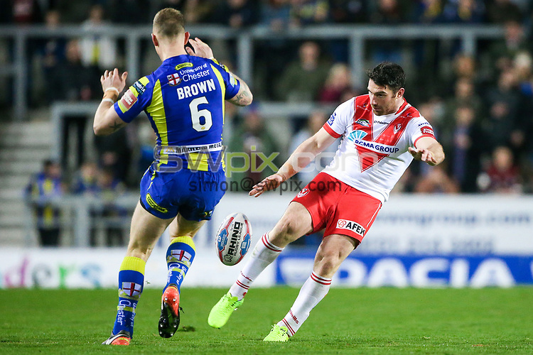 Picture by Alex Whitehead/SWpix.com - 24/03/2017 - Rugby League - Betfred Super League - St Helens v Warrington Wolves - The Totally Wicked Stadium, St Helens, England - St Helens' Matty Smith kicks, attempted charge down by Warrington's Kevin Brown.