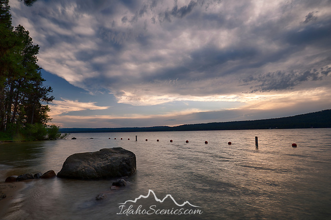 Idaho, West Central, McCall. Payette Lake under cloudy skies on a summer evening.