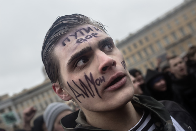 "Protester with ""Putin is a thief"" written on his forehead on Saint Petersburgs Palace Sqaure in front of the Winter Palace as part of the anti-corruption protest, organised by Russia oppositional Alexsei Navalny in Saint Petersburg and the rest of Russia on the 26.03.2017. With thouasands particpating these are the biggest demonstrations in Russia since 2011."