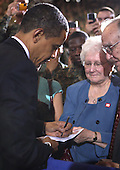 Camp Lejeune, N.C. - February 27, 2009 -- United States President Barack Obama signs an autograph for an unidentified woman after speaking to troops and civilians during his visit to Camp Lejeune, North Carolina on Friday, February 27, 2009. Obama was on Camp Lejeune to discuss current policies and an exit strategy from Iraq..Credit: Michael J. Ayotte - USMC via CNP