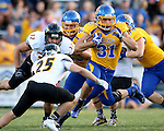 BROOKINGS, SD - SEPTEMBER 20:  Zach Zenner #31 from South Dakota State gets a step past Anthony Fassett #25 from Wisconsin-Oshkosh in the first half of their game Saturday at Coughlin Alumni Stadium in Brookings. (Photo/Dave Eggen/Inertia)