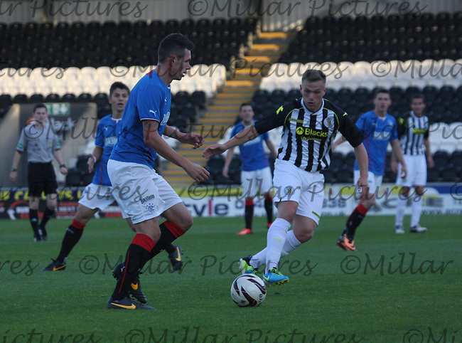 Kyle McAusland clearing watched by Kealan Dillon in the St Mirren v Rangers Scottish Professional Football League Under 20 match played at St Mirren Park, Paisley on 10.9.13.