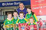 STAR: Kieran Star Donoghy of Ulster Bank, Ashe Street, Tralee welcoms young customers to the bank on Customers Service Day of the Ulster bank in Aid of Special Olympics Ireland. Garry Howard,Sean Bissott, Sean Daly,Sarah O'Donoghue and Gillian Bissett,..