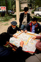 Men playing mah jongg in Beijing China