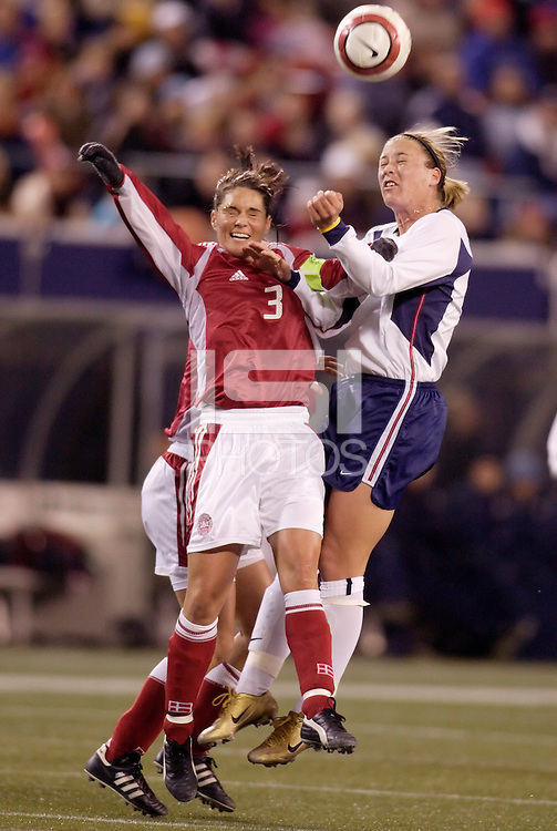 "Denmark's Katrine Pedersen battles Abby Wambach of the USA for a header. The US Women's National Team tied the Denmark Women's National Team 1 to 1 during game 8 of the 10 game the ""Fan Celebration Tour"" at Giant's Stadium, East Rutherford, NJ, on Wednesday, November 3, 2004.."
