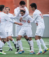 NWA Democrat-Gazette/ANTHONY REYES &bull; @NWATONYR<br /> Salvador Gonzalez (12), Springdale freshman, celebrates a first half goal with teammates against Fort Smith Northside Thursday, March 19, 2015 at Bulldog Stadium in Springdale. The Bulldogs won on penalty kicks after a 2-2 tie at the end of regulation.