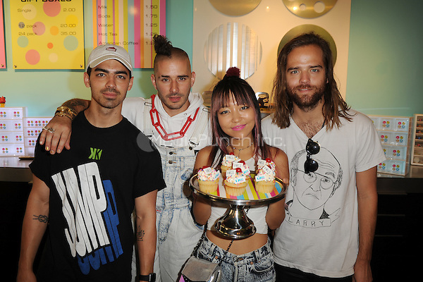 MIAMI, FL - JUNE 11: Joe Jonas, Cole Whittle, JinJoo Lee and Jack Lawless of DNCE attend Radio Station Y-100's cup cake and toothbrush party at LA Sweets on June 11, 2016 in Miami, Florida. Credit: mpi04/MediaPunch