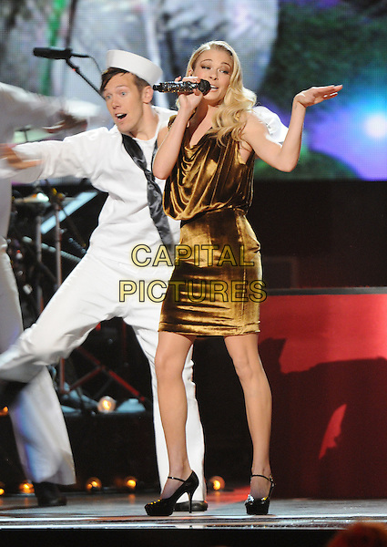 "LeANN RIMES.""CMA Country Christmas"" Taping held at Bridgestone Arena, Nashville, Tennessee, USA..November 11th, 2010.stage concert live gig performance singing full length sailors brown dress singing hand arm.CAP/ADM/LF.©Laura Farr/AdMedia/Capital Pictures."