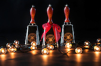 Chrome cowbells with large christmas lights in studio on black background (photo by Beth Wynn / © Mississippi State University)