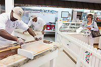People watch as Daniel Ferguson, 50, (left), and Davian Miller, 24, (center rear) make fudge at Murdick's Fudge in Edgartown, Martha's Vineyard, Massachusetts, USA. Ferguson is from Jamaica and has an H2B seasonal foreign worker visa. He says 2017 is his sixth summer season working in the fudge shop. During off-months, he returns to Jamaica where he can be with family and escape the cold weather. Miller has worked here for two seasons, and Scott for four seasons. Most of the shop's workers are seasonal foreign workers. Other companies on Martha's Vineyard and around the US had difficulty obtaining H2B visas, but Murdick's Fudge received all it requested.