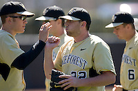 Starting pitcher Phil Negus #22 of the Wake Forest Demon Deacons is congratulated by teammates after working out of a jam versus the Duke Blue Devils at Jack Coombs Field March 29, 2009 in Durham, North Carolina. (Photo by Brian Westerholt / Four Seam Images)