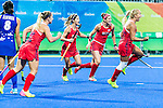 Kelsey Kolojejchick #7 of United States leads the goal celebration for Katie Bam #16 of United States, Katie Reinprecht #14 of United States and Rachel Dawson #8 of United States during USA vs Japan in a Pool B game at the Rio 2016 Olympics at the Olympic Hockey Centre in Rio de Janeiro, Brazil.