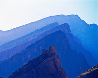 Mountain Ridges & Persian Ruin, Sultanate of Oman Western Hagar Mountains   2,000 year old castle remains   Arabian Pennisula