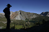 Eight miles into the wilderness along the John Muir Trail, Ed Sauls of Laguna Beach watches as the sun begins to set over secluded Purple Lake. Sauls is a frequent flyer of weekend mule trips, this photograph is from a trip in August 2006.