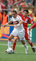 16 May 09: Chicago Fire midfielder Cuauhtemoc Blanco #10 and Pablo Vitti #8 in action at BMO Field in a game between the Chicago Fire and Toronto FC..Chicago Fire won 2-0..